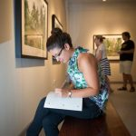 A Randolph College student studies in the Museum